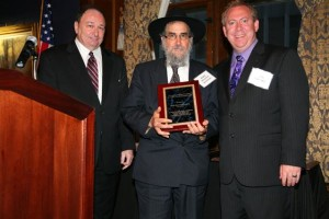 Rabbi Binyomin Scheiman receives the Hon. Gerald C. Bender Humanitarian Award from MC Justice Michael Hyman and Decalogue President James Goldberg